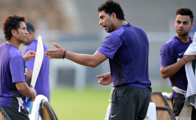 Sachin_Tendulkar_and_Yuvraj_Singh_have_a_chat_during_training_Mumbai_November_9_2012
