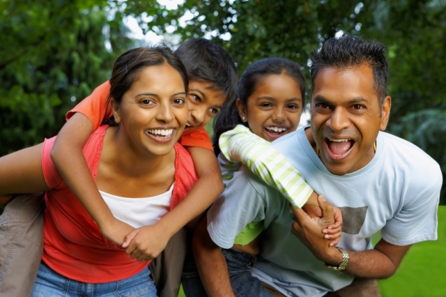 H12a-Canada-Indian-family-playing-outdoors-Mitchell-Dean