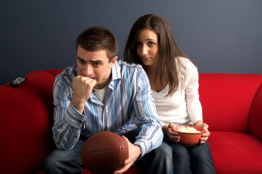 bored-woman-watching-football-with-husband