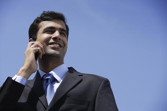 businessman-on-phonepictureindia---indian-businessman-talking-on-phone-outside-yt4ehqhr