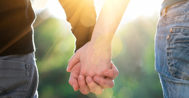 young-couple-holding-hands