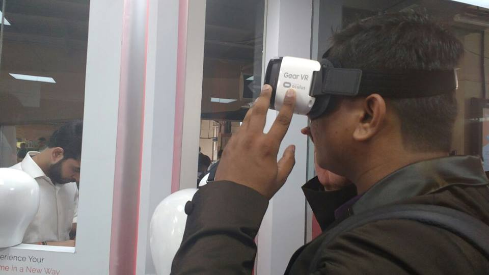 The person is experiencing virtual reality at the center at Magic bricks WEH Metro Station
